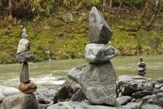 Stone cairns along a river.