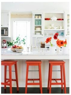 White kitchen with orange & turquoise accents.