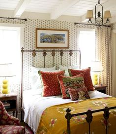The combo of ceiling, vintage wallpaper, and quilts. YES!