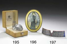 Three objects by Fabergé: a rare and unusual silver and gilt round rococo table lighter, the top cast and chased to imitate flames, Moscow, 1896-1908; a silver-gilt and yellow guilloché enamel photograph frame, Anders Nevalainen, St. Petersburg, 1896-1908; and an unusual silver and red and blue enamel menu holder shaped as the uniform collar of the 2nd Tsarskoe Selo Rifle Guards battalion, Henrik Wigström, St. Petersburg, 1908-1917.
