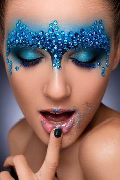 Pretty blue glitter and gemstone make-up mask by MUA Shkola Masterskaya Krasoty.