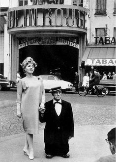 Zsa Zsa Gabor and Buster Keaton on a photo shoot outside the Moulin Rouge