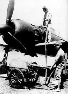 ZERO ~ Mitsubishi A6M5 Zero being fueled for mission Saipan 1944 ~ BFD