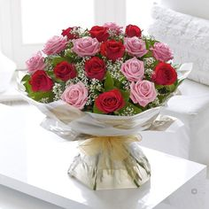 Heavenly Red and Pink Rose Hand tied.  Sending a bouquet of beautiful roses says it all. And you can relax in the knowledge that your Interflora florist will select the finest, large-headed red and pink roses to create a hand-tied bouquet guaranteed to take their breath away.