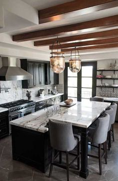 Beautiful back splash tile and counter tops in this kitchen! #kitheninspiration #kitchenremodel www.remodelworks.com