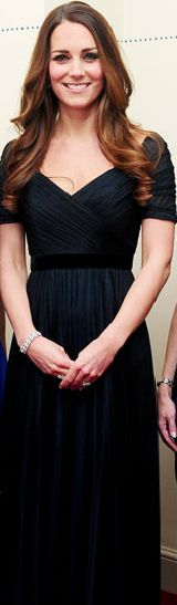 Catherine, Duchess of Cambridge, aka Kate Middleton, hosts the 100 Women in Hedge Funds dinner at Kensington Palace. The event benefits Action on Addiction, one of Kate's patronages. She is wearing an ink blue tulle gown from Jenny Packham. 10/24/13