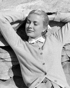 <p>Reclining in a cardigan in 1955.</p>