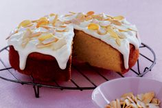 Sit+down+to+a+slice+or+two+of+this+gorgeous+orange+cake+with+sour+cream+icing.+A+favorite+of+Taste+members!