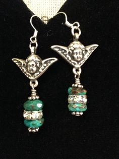 Vintage silver turquoise and cherub earrings on Etsy, $30.00