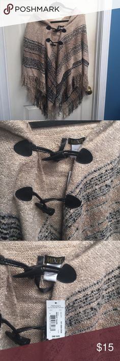 NWT Beige Cape with Fringe NWT Never worn beige cape with tan, grey and black stripes. Two toggles with faux leather detailing and fringe. Great neutral piece for winter that can be dressed down with jeans and riding boots or over a dress. Very warm! ONE SIZE. Mixit Jackets & Coats Capes