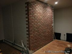 DIY Brick Wall: install weathered brick on regular drywalled wall by first adding metal sheets (screwed into studs) that are specifically meant to hold up the weight of brick and have spacers for the rows. Brick Love, Part II from My Crappy House.