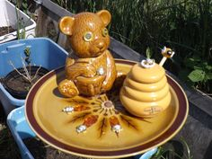 yard art - a birdfeeder I made. Has a Beary cute bear, a honey pot, bees, and beads for embellishments. Sold immediately. He is on a vase glued to the bottom of the plate,which fits over a pvc pipe
