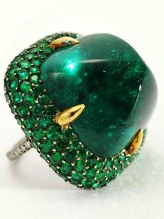JAR Paris. Emerald and diamond ring by JAR. Set with a sugarloaf cabochon emerald weighing approximately 39,74 cts, within a bombé pavé-set emerald surround, mounted in silver and gold. Price Realized $363,200 / Estimate $80,000 - $120,000 [C. MAGNIFICENT JEWELS FROM THE COLLECTION OF ELLEN BARKIN - 10 October 2006 - New York, Rockefeller Plaza] #JAR #JARParis #JoelArthurRosenthal