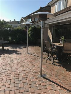 Nice integration Tropic Heating's vault box into the the paved patio.  The Sunglo PSA265 patio heaters can be removed and stored if desired