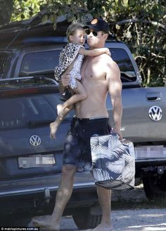Surf's up! Chris Hemsworth, showed off his ripped physique as he enjoyed a day at the . Hot Dads, Matt Damon, Surfs Up, Swim Wear, Chris Hemsworth, Daily Mail, Physique, Celebrity, Beach