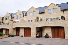 A beautiful stone masonry house featuring wide stone arches