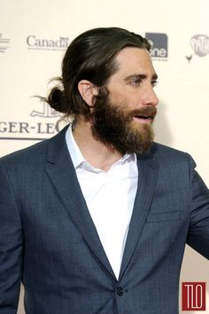 Jake Gyllenhaal, sporting a man bun and one hell of a beard. Yum.