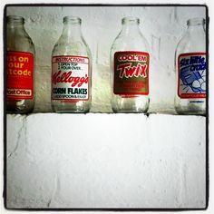 Old milk bottles Old Milk Bottles, Vintage Milk Bottles, Vintage Tins, Glass Bottles, Brand Design, Vintage Advertisements, Country Decor, Childhood Memories, Nostalgia