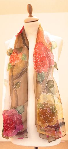 This scarf has been sold,but can be made to order Processing time:1-2 weeks This is a gorgeous one of a kind,hand painted,super soft feel floral chiffon scarf intricately painted on pure white background.Each flower has a swarovski bead embroidered at the centre. Its an absolute joy wearing this delicate piece of art as it drapes beautifully! the sheer transparency of chiffon is perfect for the upcoming spring season,can be worn with a pastel coloured or plain white chiffon top The size…
