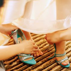 The bride's shoes are turquoise with silver glitter - See more at: http://magazine.fourseasons.com/weddings/real-weddings/outdoor-wedding-in-jakarta#sthash.xqP01Uqb.dpuf