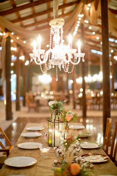 a barn dripping in chandeliers  Photography By / harwellphotography.com, Event Planning By / thebelleoftheball.com