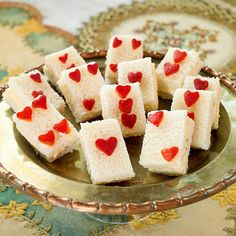 Have a Heart Card Sandwiches:    The 1/2-inch hearts cut from chopped roasted red peppers add the Alice in Wonderland twist to these easy-to-make cheese sandwich appetizers.
