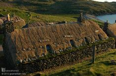 These are the stone blackhouses of Gearrannan on the Isle of Lewis, Scotland. Originally built to share with farm animals, they were called black because they were smoke filled to preserve the thatch. More to discover about natural living at www.naturalhomes.org