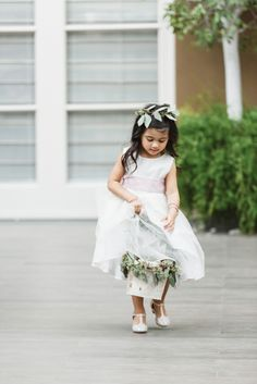 The cutest little flower girl: http://www.stylemepretty.com/california-weddings/los-angeles/2016/01/29/whimsical-fall-four-seasons-los-angeles-wedding/ | Photography: Jana Williams - http://jana-williams.com/