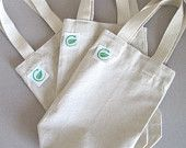 green bags wine tote,  20 for $56.    etsy      we could silk screen them here