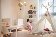 An absolutely adorable room for a little girl. It has everything - colorful hot air balloons, a tipi for reading or napping, and a stylish Magis Puppy that doubles as a fun little chair. A room this whimsical is sure to spark the imagination.