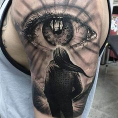 Tattoo woman looks in 3D eye - Title