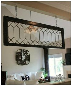 Hang a vintage leaded glass window with eye hooks/bolts & chains ~ Kitchen Decorating Ideas You Will Love!