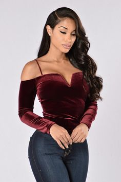 - Available in Burgundy - Off Shoulder Top - Velvet - Long Sleeve - Spaghetti Straps - V Bar Neckline - Made in USA - 66% Polyester 29% Rayon 5% Spandex