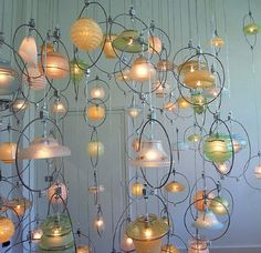 Old light fixtures transformed into a gorgeous chandy. DIY Chandelier