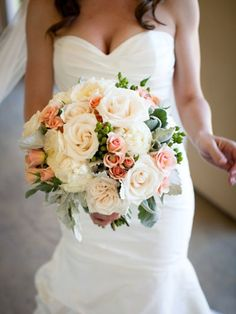 The bridal bouquet will be a clutch of cream hydrangeas, ivory garden roses, pale green succulents, pale pink spray roses, silver brunia, and grey dusty miller wrapped in ribbon with pearl pins and the stems showing.