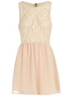 Adorable dress. Sleeveless lace for the bodice and a light pink skirt.