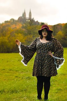 Witchy, vintage, retro, feminine style; plus size curvy outfit with bell sleeves, dark florals, and floppy wool hat.  The Classy Junk