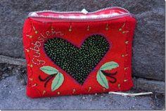 An embroidered woolen felt pouch.