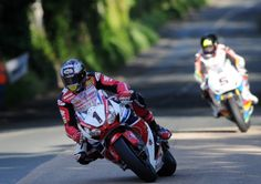 Honda Racing rider John McGuinness leads Bruce Anstey at Ballacraine during opening qualifying at the 2014 Isle of Man TT. Picture:  Pacemak...