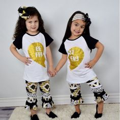 "Girl's ""Best Friend"" black and gold Aztec Capri Boutique Outfits. You choose which one or purchase both for those little best friends you know!     Accessories not included. Matching accessories can be purchased in our shop. (Sandals not available) Follow links below for matching accessories..    https://www.etsy.com/listing/259367387/solid-black-headband-with-5-gold-sequin    https://www.etsy.com/listing/262232780/trendy-bling-black-gold-chunky-necklace…"