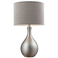 Accent your home decor with this modern table lamp featuring a beautiful hammered chrome-plated base finish. This effulgent lamp also features a charming fabric shade and a convenient on/off socket switch.