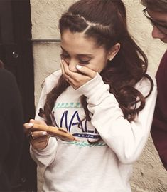 Ariana Grande is so pretty and sings so well! Great actress, too. I love her phone case in this pic!