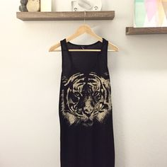 Tiger Maxi Black maxi with tiger print. 62% Polyester 38% Rayon About 46 inches long. Make me an offer :) Forever 21 Dresses