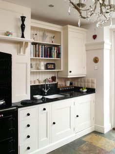 Edwardian painted kitchen This lovely Edwardian home has so many original features including an authentic butler's pantry. The painted kitchen cabinets match perfectly, and the oak fridge housing makes a striking contrast.