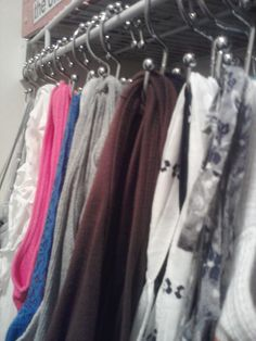 Used shower curtain hooks to hang up all my tank tops in my closet- so much easier to access than from a hanger and way nicer than having them in a drawer.  Click on the picture for a link to the shower curtain hooks I used that are double sided!