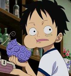 Monkey D. Luffy eating the devil fruit that gave him his rubber powers. – Monkey D Luffy
