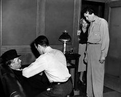 Walter Huston, Humphrey Bogart, Lee Patrick, John Huston on-set of The Maltese Falcon (1941)