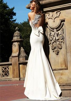 beautiful wedding dress, not into the too-fancy silver thing on the back..
