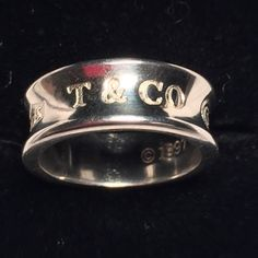 Vin Tiffany & Company 925 Sterling Silver Ring Mothers Day Sale/bundle discounts do not apply. Vintage Tiffany & Company 925 Sterling Silver Ring Marked. Proudly inscribed with the year Tiffany was founded, the Tiffany 1837® collection is defined by sleek curves and contours. This elegant ring embodies a timeless aesthetic.  Sterling silver Medium. Authentic Tiffany. Note: We are not experts in any item (jewelry, art, designers, etc.) we may not catch every defect or deficiency.  H=0.6mm…
