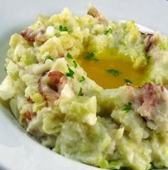 Colcannon, a traditional Irish dish associated with Halloween, is made with potatoes and savoy cabbage and served with a well of butter in its center.